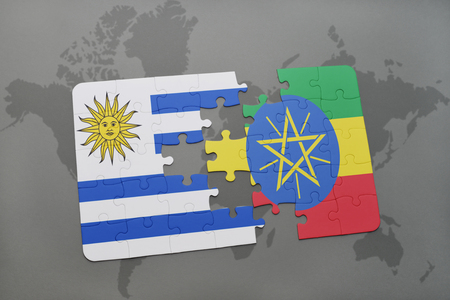 puzzle with the national flag of uruguay and ethiopia on a world map background. 3D illustration