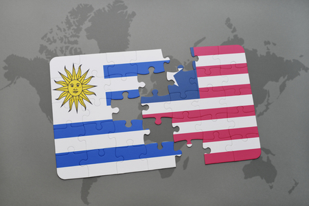 puzzle with the national flag of uruguay and liberia on a world map background. 3D illustration