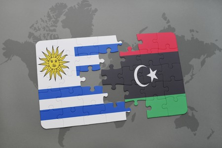 puzzle with the national flag of uruguay and libya on a world map background. 3D illustration Stock Photo