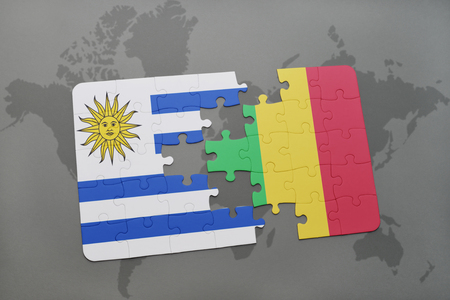 puzzle with the national flag of uruguay and mali on a world map background. 3D illustration