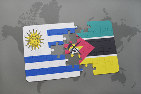 puzzle with the national flag of uruguay and mozambique on a world map background. 3D illustration
