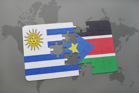 puzzle with the national flag of uruguay and south sudan on a world map background. 3D illustration