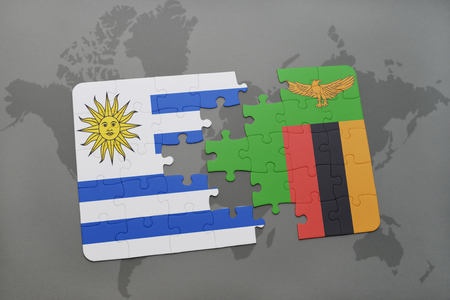 puzzle with the national flag of uruguay and zambia on a world map background. 3D illustration