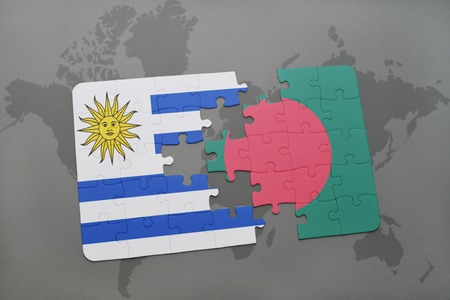 puzzle with the national flag of uruguay and bangladesh on a world map background. 3D illustration Stock Photo