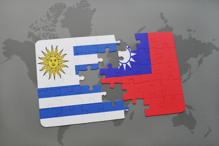puzzle with the national flag of uruguay and taiwan on a world map background. 3D illustration