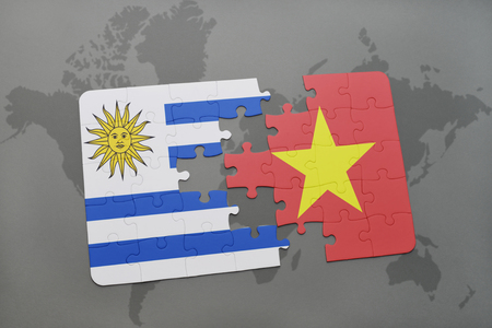 puzzle with the national flag of uruguay and vietnam on a world map background. 3D illustration