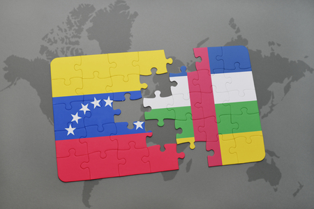 puzzle with the national flag of venezuela and central african republic on a world map background. 3D illustration
