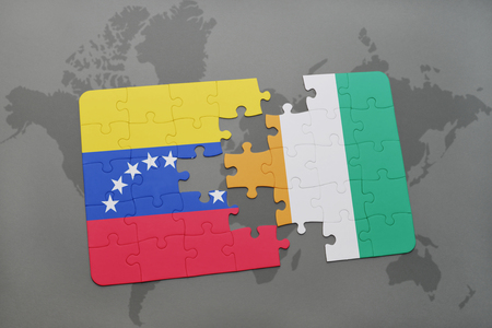 puzzle with the national flag of venezuela and cote divoire on a world map background. 3D illustration Stock Photo