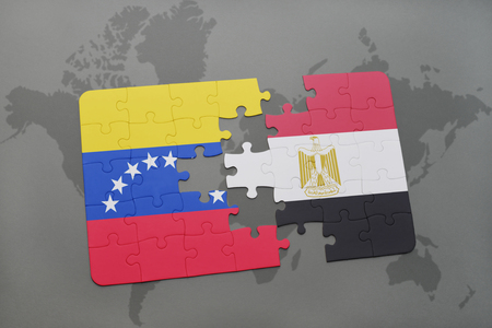 venezuelan flag: puzzle with the national flag of venezuela and egypt on a world map background. 3D illustration Stock Photo