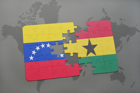 puzzle with the national flag of venezuela and ghana on a world map background. 3D illustration Stock Photo