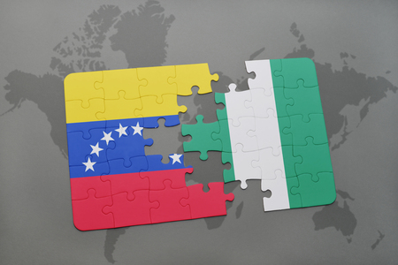 puzzle with the national flag of venezuela and nigeria on a world map background. 3D illustration