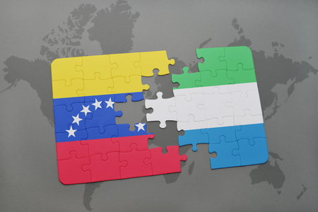 puzzle with the national flag of venezuela and sierra leone on a world map background. 3D illustration Stock Photo