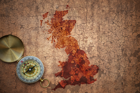 map of great britain on a old vintage crack paper background with compass Stock Photo