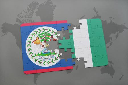 puzzle with the national flag of belize and nigeria on a world map background. 3D illustration Stock Photo