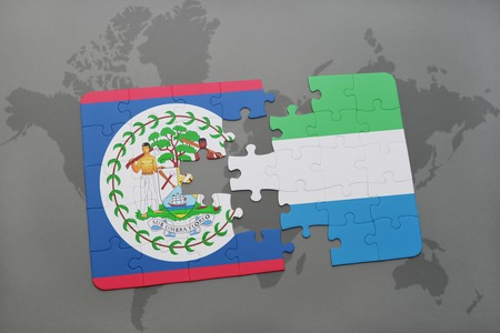puzzle with the national flag of belize and sierra leone on a world map background. 3D illustration