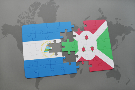 puzzle with the national flag of nicaragua and burundi on a world map background. 3D illustration Stock Photo