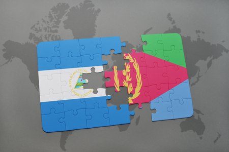 puzzle with the national flag of nicaragua and eritrea on a world map background. 3D illustration Stock Photo