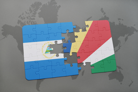 puzzle with the national flag of nicaragua and seychelles on a world map background. 3D illustration