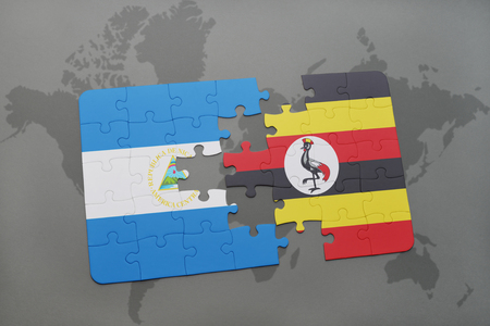 puzzle with the national flag of nicaragua and uganda on a world map background. 3D illustration
