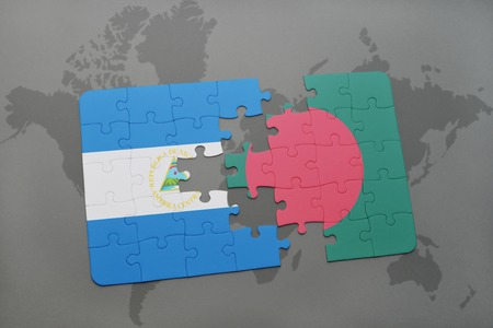 puzzle with the national flag of nicaragua and bangladesh on a world map background. 3D illustration Stock Photo