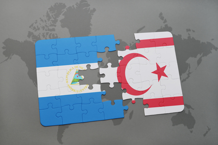 puzzle with the national flag of nicaragua and northern cyprus on a world map background. 3D illustration Stock Photo