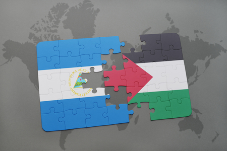 puzzle with the national flag of nicaragua and palestine on a world map background. 3D illustration