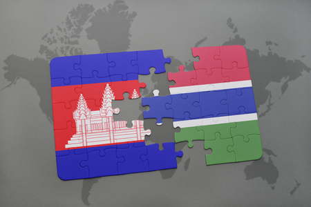 puzzle with the national flag of cambodia and gambia on a world map background. 3D illustration Stock Photo