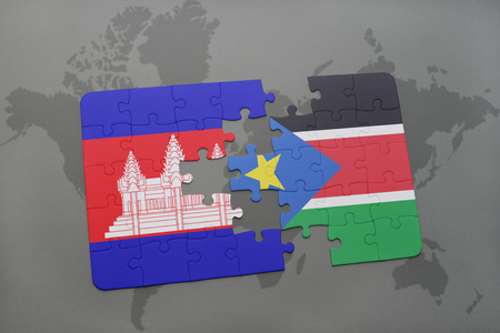 puzzle with the national flag of cambodia and south sudan on a world map background. 3D illustration