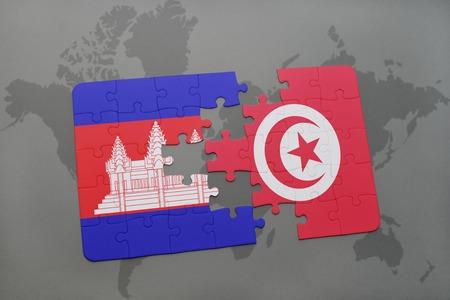 世界地図背景にカンボジアとチュニジアの国旗パズルします。3 D イラストレーション