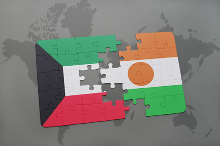puzzle with the national flag of kuwait and niger on a world map background. 3D illustration Stock Photo