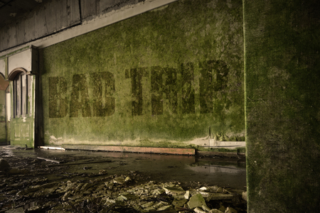junky: text bad trip on the dirty old wall in an abandoned ruined house Stock Photo
