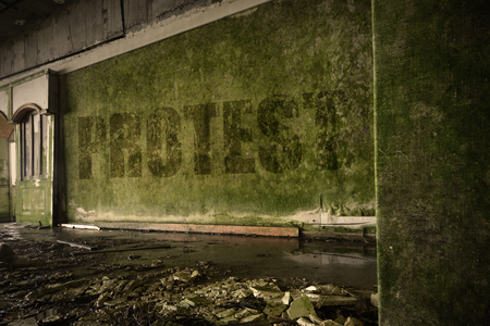 dirtiness: text protest on the dirty old wall in an abandoned ruined house