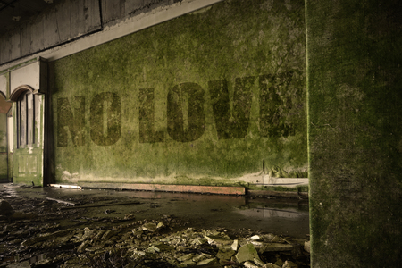 dirtiness: text no love on the dirty old wall in an abandoned ruined house Stock Photo