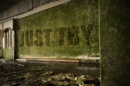 dirtiness: text just try on the dirty old wall in an abandoned ruined house