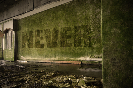 text never on the dirty old wall in an abandoned ruined house