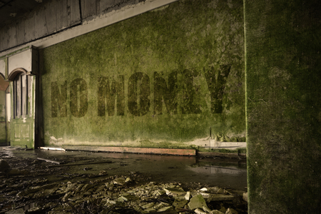 dirtiness: text no money on the dirty old wall in an abandoned ruined house