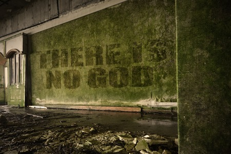 junky: text there is no god on the dirty old wall in an abandoned ruined house