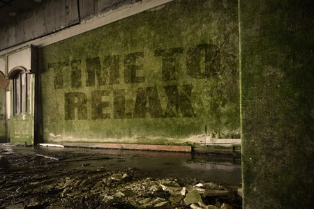dirtiness: text time to relax on the dirty old wall in an abandoned ruined house