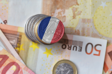 euro coin with national flag of france on the euro money banknotes background. finance concept Stock Photo