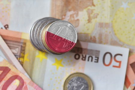 euro coin with national flag of poland on the euro money banknotes background. finance concept Stock Photo