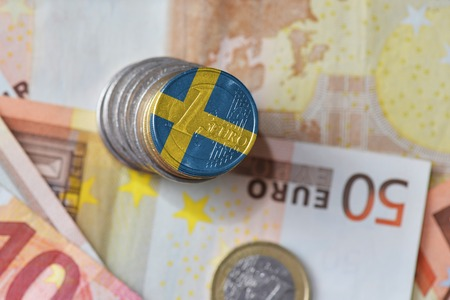 euro coin with national flag of sweden on the euro money banknotes background. finance concept