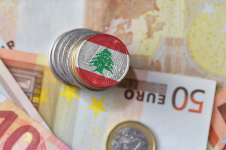 euro coin with national flag of lebanon on the euro money banknotes background. finance concept Zdjęcie Seryjne
