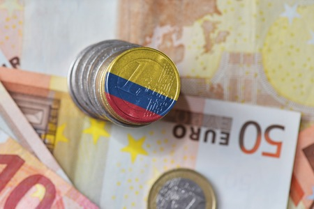 euro coin with national flag of colombia on the euro money banknotes background. finance concept Stock Photo