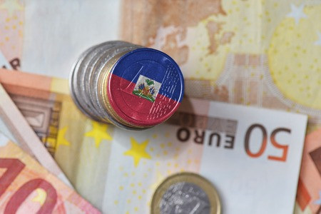euro coin with national flag of haiti on the euro money banknotes background. finance concept