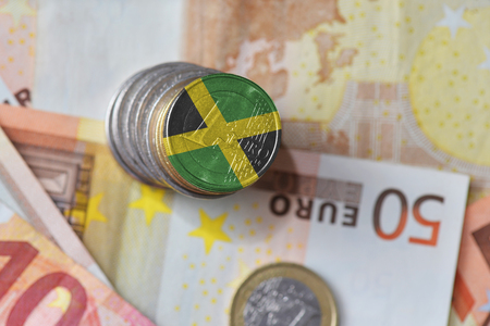 euro coin with national flag of jamaica on the euro money banknotes background. finance concept