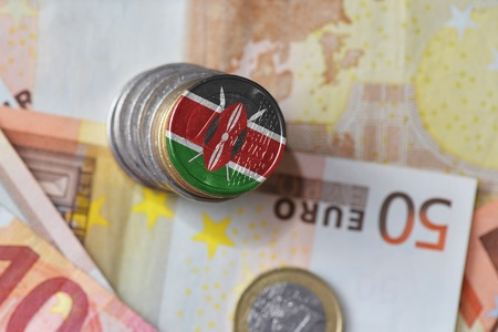 euro coin with national flag of kenya on the euro money banknotes background. finance concept Stock Photo