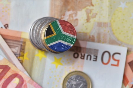 euro coin with national flag of south africa on the euro money banknotes background. finance concept 写真素材