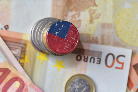 euro coin with national flag of Samoa on the euro money banknotes background. finance concept Stock Photo