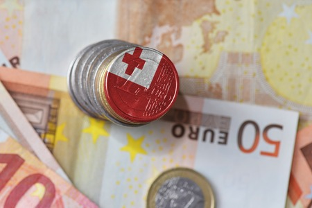 euro coin with national flag of Tonga on the euro money banknotes background. finance concept Stock Photo