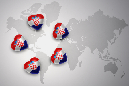 five hearts with national flag of croatia on a world map background..concept.3D illustration Stock Photo